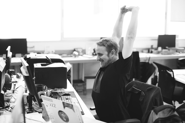 man getting a nice stretch at work