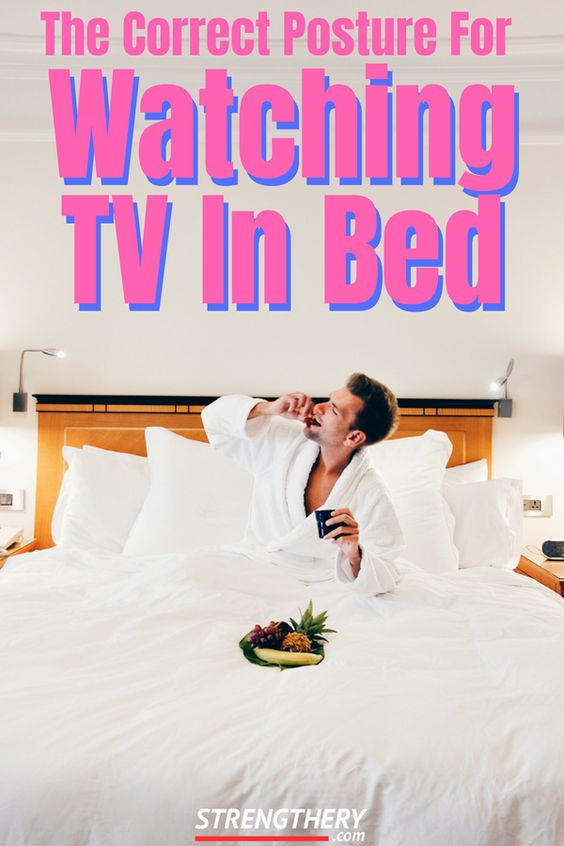 man sitting in the bed perhaps watching tv