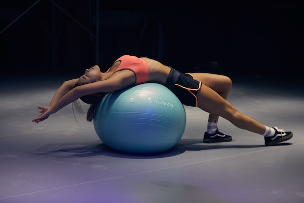 woman exercising on a stabilisation ball