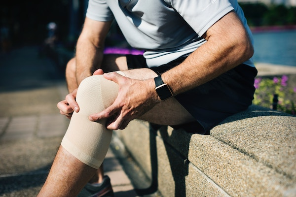 man with injured knee