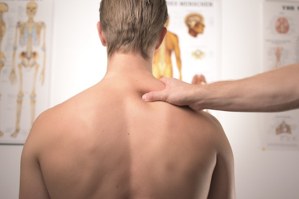 man getting massage for his sore neck due to poor posture