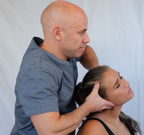 man massing woman's scalp