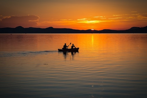 two people rowing